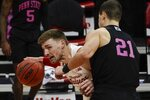 Wisconsin's Micah Potter tries to get past Penn State's John Harrar during the first half of an NCAA college basketball game Tuesday, Feb. 2, 2021, in Madison, Wis. (AP Photo/Morry Gash)