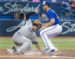 New York Yankees' Breyvic Valera scores on a wild pitch as Toronto Blue Jays pitcher Thomas Pannone tries to make a play during the third inning of a baseball game Thursday, Aug. 8, 2019, in Toronto. (Fred Thornhill/The Canadian Press via AP)