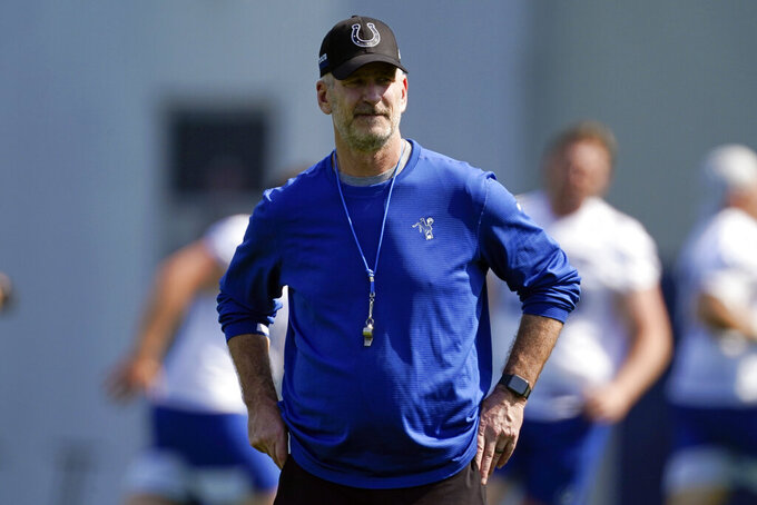 FILE - Indianapolis Colts head coach Frank Reich watches during NFL football practice in Indianapolis, in this Thursday, May 20, 2021, file photo. Reich will miss the start of training camp after testing positive for COVID-19, general manager Chris Ballard announced Monday, July 26, 2021. (AP Photo/Darron Cummings, File)