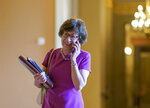 Sen. Susan Collins, R-Maine, one of the bipartisan infrastructure negotiators, walks through a corridor on her way to the chamber, at the Capitol in Washington, Tuesday, July 13, 2021. (AP Photo/J. Scott Applewhite)