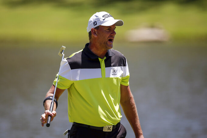 Robert Karlsson, of Sweden, reacts to his missed putt on the fourth hole during the final round of the Regions Tradition Champions Tour golf tournament Sunday, May 9, 2021, in Hoover, Ala. (AP Photo/Butch Dill)
