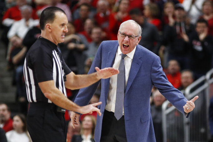 Syracuse head coach Jim Boeheim reacts to having a technical foul called on him by official Roger Ayers during the second half of an NCAA college basketball game against Louisville Wednesday, Feb. 19, 2020, in Louisville, Ky. Louisville won 90-66. (AP Photo/Wade Payne)