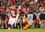 Oklahoma linebacker Curtis Bolton (18) breaks up a pass intended for Oklahoma State running back Chuba Hubbard (30) in the second half of an NCAA college football game in Norman, Okla., Saturday, Nov. 10, 2018. Oklahoma won 48-47. (AP Photo/Alonzo Adams)