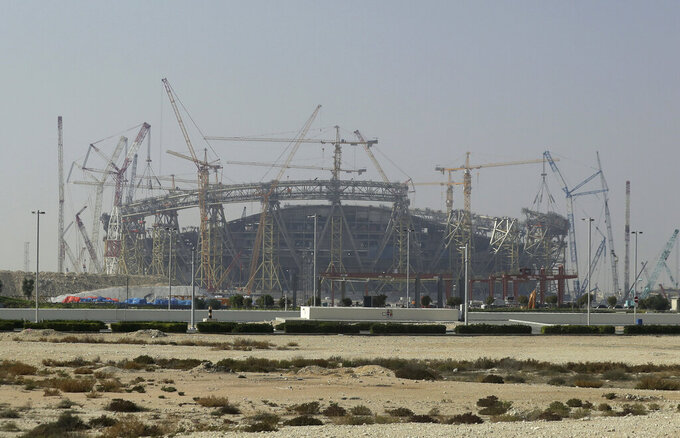FILE - In this file photo dated Friday, Dec. 20, 2019, construction underway at the Lusail Stadium, one of the 2022 World Cup stadiums, in Lusail, Qatar.   The gas-rich Persian Gulf nation Monday July 27, 2020, Qatar has expressed an interest in hosting the world's biggest sporting events, the 2032 Olympic and Paralympic Games, in a letter to the International Olympic Committee.(AP Photo/Hassan Ammar, FILE)