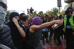 Women protest against the latest murder of two women, in Mexico City, Saturday, Jan. 25, 2020. During the past couple of weeks two women activists, attorney Yunuen Lopez Sanchez and Isabel Cabanillas de la Torre where murdered by unknown assailants. (AP Photo/Ginnette Riquelme)