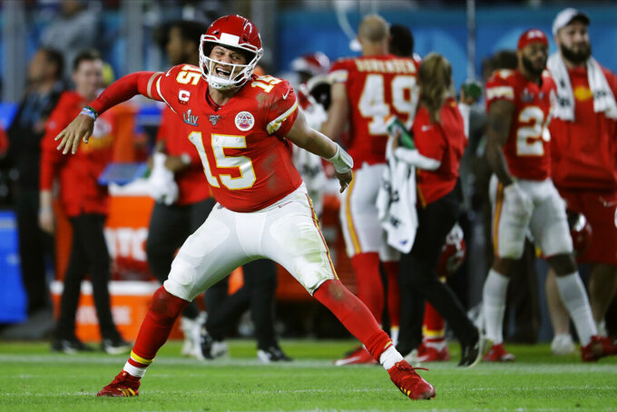 Kansas City Chiefs' quarterback Patrick Mahomes celebrates his touchdown pass to Damien Williams in the the second half of the NFL Super Bowl 54 football game on Feb. 2, 2020, in Miami Gardens, Fla. (AP Photo/John Bazemore)