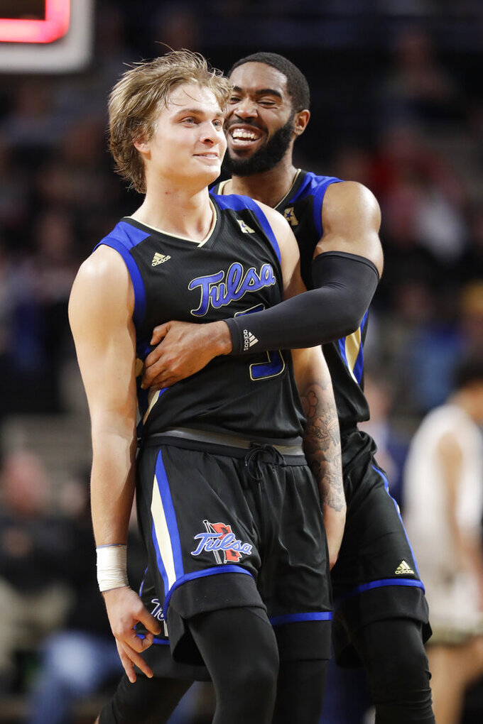 Tulsa forward Jeriah Horne, right, hugs guard Lawson Korita after Korita made a shot at the buzzer in the first half of the team's NCAA college basketball game against Vanderbilt on Saturday, Nov. 30, 2019, in Nashville, Tenn. (AP Photo/Mark Humphrey)