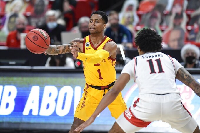 Iowa State's Tyler Harris (1) passes the ball away from Texas Tech's Kyler Edwards (11) during the second half of an NCAA college basketball game in Lubbock, Texas, Thursday, March 4, 2021. (AP Photo/Justin Rex)