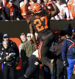 Cleveland Brown's Kareem Hunt makes a catch against the Baltimore Ravens during an NFL football game at FirstEnergy Stadium in Cleveland on Sunday, Dec. 22, 2019. (Warren Dillaway/The Star-Beacon via AP)