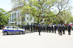 Police block a group of government workers protesting against the rise in cost of living in Harare, Wednesday, Nov, 6, 2019. Zimbabwe police Wednesday blocked government workers from marching to protest for better salaries, a day after dozens of public hospital doctors were fired for striking for more pay. (AP Photo/Tsvangirayi Mukwazhi)
