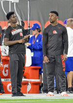 Cleveland Browns cornerback Greedy Williams, left, and strong safety Morgan Burnett watch from the sideline during the first half of an NFL football game against the Los Angeles Rams, Sunday, Sept. 22, 2019, in Cleveland. (AP Photo/David Richard)