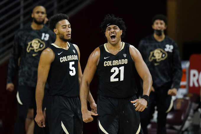 Colorado's Evan Battey celebrates his basket during the second half of the team's NCAA college basketball game against Southern California, Thursday, Dec. 31, 2020, in Los Angeles. Colorado won 72-62. (AP Photo/Jae C. Hong)