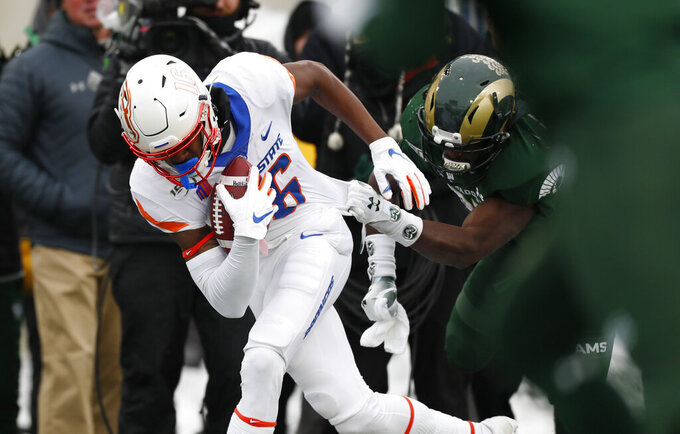 Boise State wide receiver John Hightower, left, is pulled down by Colorado State safety Logan Stewart after catching a pass for a short gain in the first half of an NCAA college football game Friday, Nov. 29, 2019, in Fort Collins, Colo. (AP Photo/David Zalubowski)