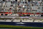 NASCAR driver Justin Allgaier crosses the finish line and wins a NASCAR Xfinity Series at Atlanta Motor Speedway on Saturday, March 20, 2021, in Hampton, Ga. (AP Photo/Brynn Anderson)
