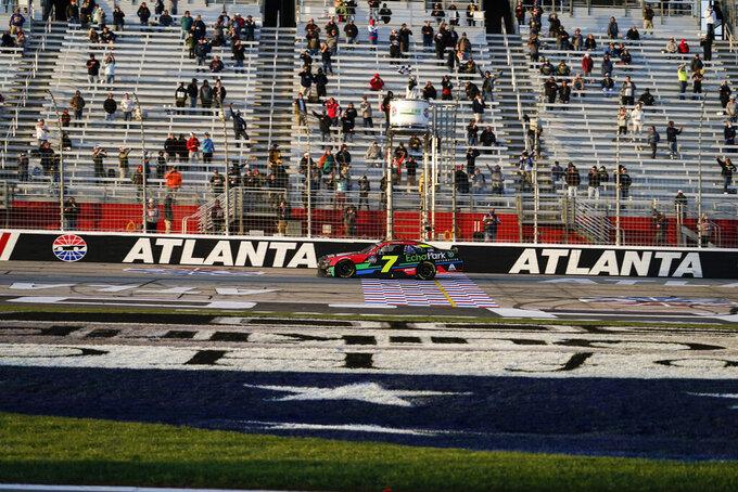 NASCAR driver Justin Allgaier crosses the finish line and wins a NASCAR Xfinity Series at Atlanta Motor Speedway on Saturday, March 20, 2021, in Hampton, Ga. (AP Photo/Brynn Anderson)