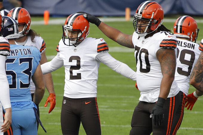 Cleveland Browns kicker Cody Parkey (2) is congratulated by Kendall Lamm (70) after Parkey kicked a 27-yard field goal against the Tennessee Titans in the first half of an NFL football game Sunday, Dec. 6, 2020, in Nashville, Tenn. (AP Photo/Ben Margot)