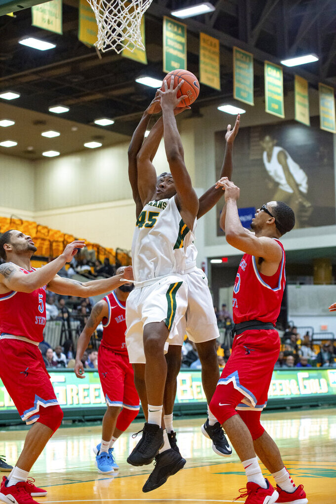 Norfolk State forward Jordan Butler (45) fights to recover a rebound against Delaware State during the first half of an NCAA college basketball game, Saturday, Jan. 5, 2019, in Norfolk, Va. (Mike Caudill/The Virginian-Pilot via AP)