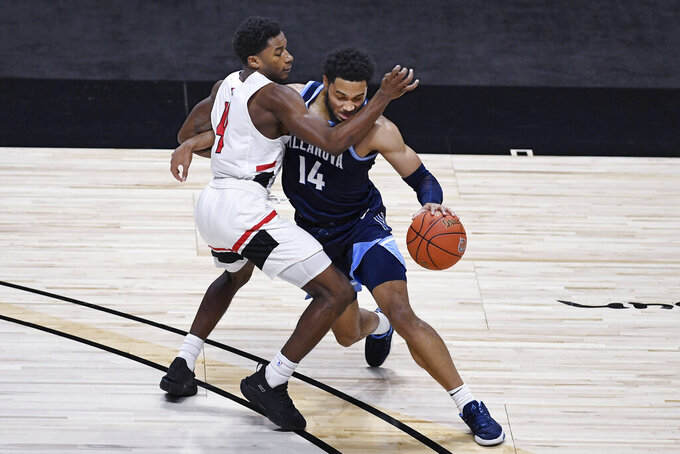 Hartford's Moses Flowers fouls Villanova's Caleb Daniels during the second half of an NCAA college basketball game, Tuesday, Dec. 1, 2020, in Uncasville, Conn. (AP Photo/Jessica Hill)