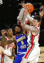 Morehead State forward James Baker (5) works for a rebound against Ohio State forward Kyle Young during the first half of an NCAA college basketball game in Columbus, Ohio, Wednesday, Dec. 2, 2020. (AP Photo/Paul Vernon)