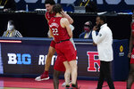 Rutgers guard Geo Baker (0) and Caleb McConnell (22) celebrate beating Clemson 60-56 after a men's college basketball game in the first round of the NCAA tournament at Bankers Life Fieldhouse in Indianapolis, Friday, March 19, 2021. (AP Photo/Paul Sancya)