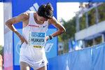 Japan's Hidekazu Hijikata reacts after crossing the finish line in the Berlin Marathon in Berlin, Germany, Sunday, Sept. 26, 2021. (AP Photo/Lisa Leutner)