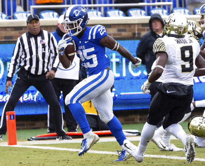 Duke's Deon Jackson (25) scores a touchdown during the first half of an NCAA college football game against Wake Forest in Durham, N.C., Saturday, Nov. 24, 2018. (AP Photo/Ben McKeown)