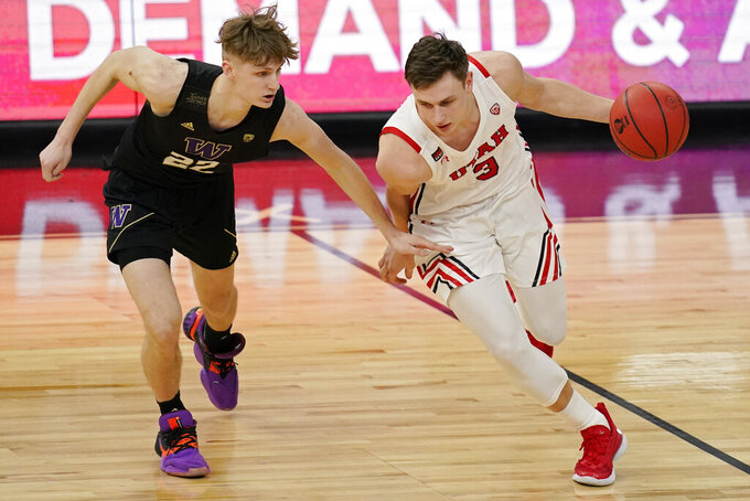 Utah's Pelle Larsson (3) drives around Washington's Cole Bajema (22) during the second half of an NCAA college basketball game in the first round of the Pac-12 men's tournament Wednesday, March 10, 2021, in Las Vegas. (AP Photo/John Locher)