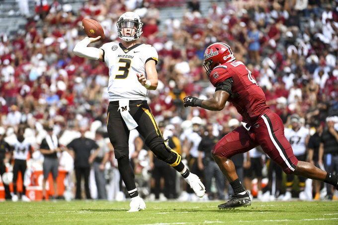 Missouri quarterback Drew Lock (3) attempts a pass against South Carolina linebacker Bryson Allen-Williams (4) during the first half of an NCAA college football game Saturday, Oct. 6, 2018, in Columbia, S.C. (AP Photo/Sean Rayford)