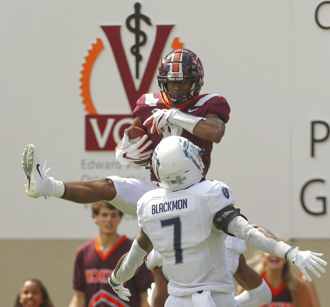 Phil Patterson (8) of Virginia Tech catches a 13 yard touchdown pass in front of Harrell Blackmon (7) of Old Dominion during the second half of an NCAA college football game  in Blacksburg Va,. Saturday, Sept. 7, 2019. (Matt Gentry/The Roanoke Times via AP)