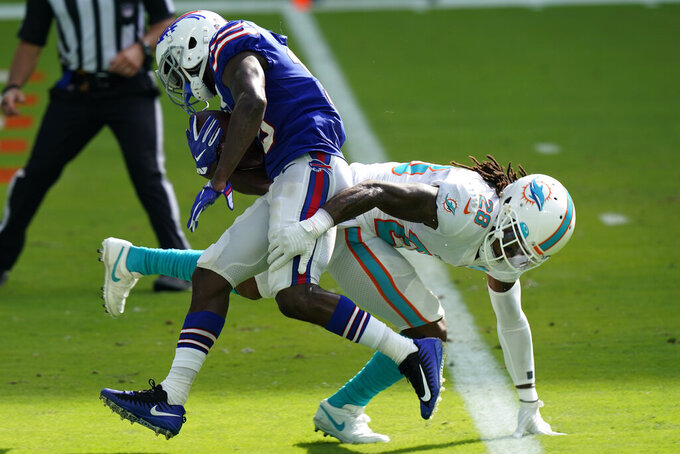 Buffalo Bills wide receiver John Brown (15) scores a touchdown as Miami Dolphins strong safety Bobby McCain (28) attempts to tackle, during the second half of an NFL football game, Sunday, Sept. 20, 2020, in Miami Gardens, Fla. The Bills defeated the Dolphins 31-28. (AP Photo/Lynne Sladky)