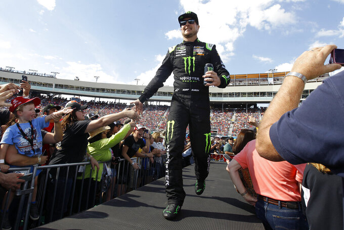 Kurt Busch greets fans during driver introductions prior to the NASCAR Cup Series auto race at ISM Raceway, Sunday, Nov. 10, 2019, in Avondale, Ariz. (AP Photo/Ralph Freso)
