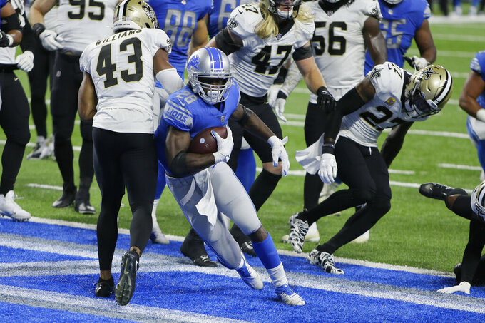 Detroit Lions running back Adrian Peterson (28) rushes for a 5-yard touchdown during the second half of an NFL football game against the New Orleans Saints, Sunday, Oct. 4, 2020, in Detroit. (AP Photo/Duane Burleson)