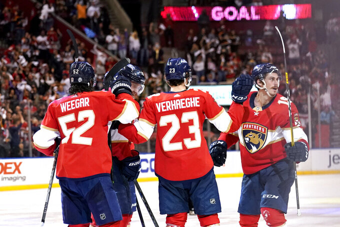 Florida Panthers left wing Mason Marchment (19) reacts after scoring a goal during the second period in Game 5 of an NHL hockey Stanley Cup first-round playoff series against the Tampa Bay Lightning, Monday, May 24, 2021, in Sunrise, Fla. (AP Photo/Lynne Sladky)