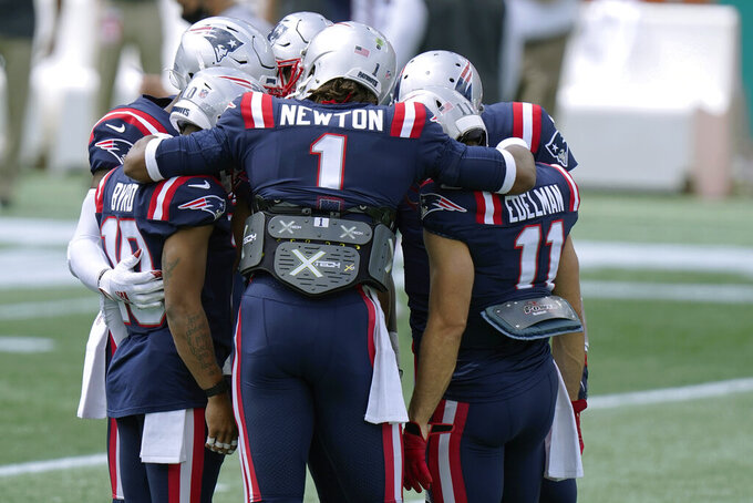 New England Patriots quarterback Cam Newton (1) huddles with New England Patriots wide receivers Damiere Byrd (10) and Julian Edelman (11) and teammates as they warm up before an NFL football game, Sunday, Sept. 13, 2020, in Foxborough, Mass. (AP Photo/Steven Senne)