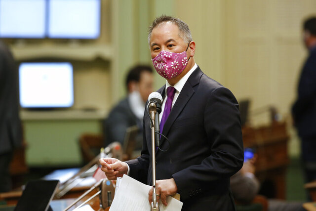 Assemblyman Phil Ting, D-San Francisco, chair of the Assembly Budget Committee, calls on lawmakers to approve the $202.1 billion 2020-2021 budget plan at the Capitol in Sacramento, Calif., on Friday, June 26, 2020. The Assembly voted 57-16 to approve the main spending plan that closes an estimated $54.3 billion deficit by temporarily raising taxes on business, cutting funding to courts, colleges and state worker salaries and delaying billions of dollars in payments to public schools. (AP Photo/Rich Pedroncelli)
