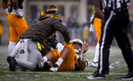 Wyoming quarterback Sean Chambers (12) lays on the field after an injury in the first quarter against Air Force in an NCAA college football game at War Memorial Stadium Saturday, Nov. 17, 2018, in Laramie, Wyo. (Josh Galemore/The Casper Star-Tribune via AP)