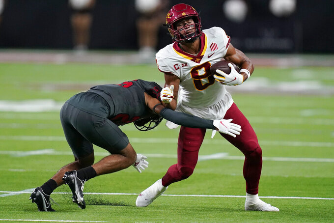 Iowa State wide receiver Xavier Hutchinson (8) runs after making a catch against UNLV defensive back Cameron Oliver (25) during the first half of an NCAA college football game Saturday, Sept. 18, 2021, in Las Vegas. (AP Photo/John Locher)