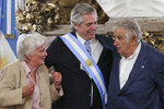 Argentina's President Alberto Fernandez ,center, greets former Uruguayan President Jose Mujica, right, and his wife Lucía Topolansky, at the presidential palace in Buenos Aires, Argentina, Tuesday, Dec. 10, 2019. Fernandez became president of Argentina on Tuesday, returning the country's Peronist political movement to power amid an economic crisis and rising poverty. (AP Photo/Daniel Jayo)