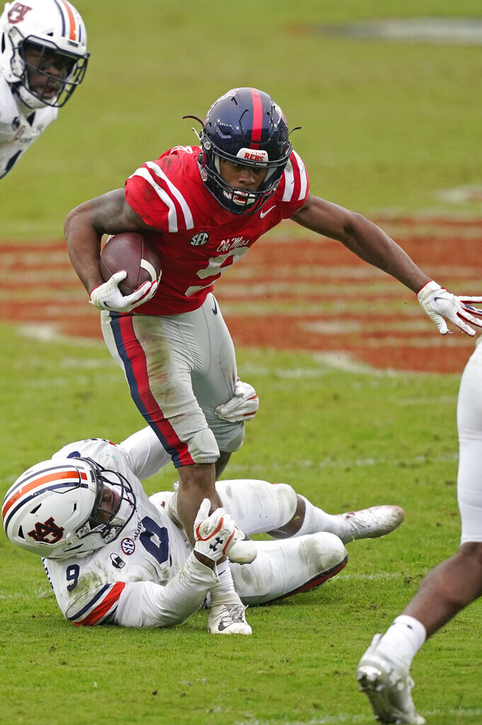 Mississippi running back Jerrion Ealy (9) is tackled by Auburn linebacker Zakoby McClain (9) during the second half of an NCAA college football game in Oxford, Miss., Saturday Oct. 24, 2020. Auburn won 35-28. (AP Photo/Rogelio V. Solis)
