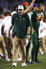 FILE - In this Friday, Aug. 31, 2018, file photo, Colorado State coach Mike Bobo walks the sideline during the second half of the team's NCAA college football game against Colorado in Denver. Bobo preaches toughness and accountability. He demonstrated that toughness last season by walking the sidelined despite fighting a rare autoimmune disease that caused him to lose sensation in both feet. He showed accountability by declining a $100,000 pay increase due to him after the Rams struggled to a 3-9 record in 2018. That's why his messages hit home.  (AP Photo/David Zalubowski, File)