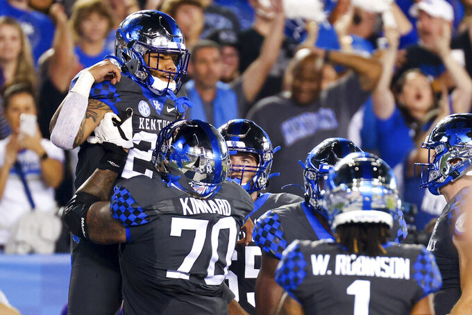 Kentucky running back Chris Rodriguez Jr., left, celebrates his touchdown during the first half of the team's NCAA college football game against LSU in Lexington, Ky., Saturday, Oct. 9, 2021. (AP Photo/Michael Clubb)