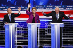 From left, Democratic presidential candidates, former New York City Mayor Mike Bloomberg, Sen. Elizabeth Warren, D-Mass.; and Sen. Bernie Sanders, I-Vt., participate in a Democratic presidential primary debate Wednesday, Feb. 19, 2020, in Las Vegas. Seven casino-resorts are among 200 caucus locations statewide that will host the presidential caucuses on Saturday. (AP Photo/John Locher)