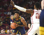 West Virginia forward Derek Culver (1) looks for an opening against Oklahoma forward Kristian Doolittle (21) during the first half of an NCAA college basketball game in Norman, Okla., Saturday, Feb. 8, 2020. (AP Photo/Kyle Phillips)