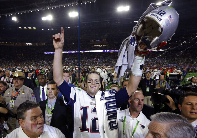"FILE - In this Feb. 1, 2015 file photo, New England Patriots quarterback Tom Brady (12) celebrates after the NFL Super Bowl XLIX football game against the Seattle Seahawks in Glendale, Ariz. Brady, the centerpiece of the New England Patriots' championship dynasty over the past two decades, appears poised to leave the only football home he has ever had. The 42-year-old six-time Super Bowl winner posted Tuesday, March 17, 2020, on social media ""my football journey will take place elsewhere."" The comments were the first to indicate the most-decorated player in NFL history would leave New England. (AP Photo/David J. Phillip, File)"