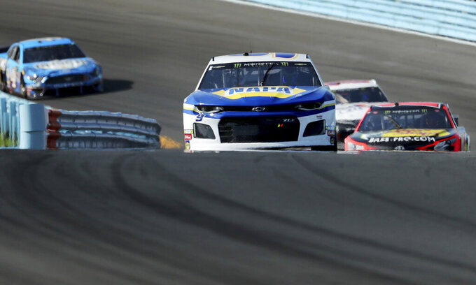 Eventual winner Chase Elliott leads midway through the race during a NASCAR Cup Series auto race at Watkins Glen International, Sunday, Aug. 4, 2019, in Watkins Glen, N.Y. (AP Photo/John Munson)