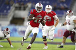 Florida Atlantic quarterback Javion Posey runs with the ball against Massachusetts during the first quarter of an NCAA college football game Friday, Nov. 20, 2020, in Boca Raton, Fla. (John McCall/South Florida Sun-Sentinel via AP)