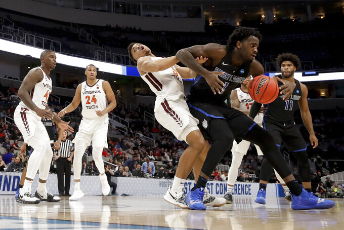 Saint Louis guard Javon Bess, right, drives to the basket around Virginia Tech guard Wabissa Bede during the second half of a first-round game in the NCAA men's college basketball tournament Friday, March 22, 2019, in San Jose, Calif. (AP Photo/Jeff Chiu)