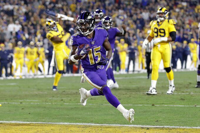 Baltimore Ravens wide receiver Marquise Brown scores against the Los Angeles Rams during the first half of an NFL football game Monday, Nov. 25, 2019, in Los Angeles. (AP Photo/Marcio Jose Sanchez)