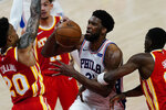 Philadelphia 76ers center Joel Embiid (21) is fouled by Atlanta Hawks forward Tony Snell (19), right, as Hawks forward John Collins (20) defends during the first half of Game 3 of a second-round NBA basketball playoff series, Friday, June 11, 2021, in Atlanta. (AP Photo/John Bazemore)