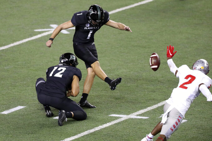 Hawaii place kicker Matthew Shipley (1) makes a field goal over New Mexico during the fourth quarter of an NCAA college football game, Saturday, Nov. 7, 2020, in Honolulu. (AP Photo/Marco Garcia)